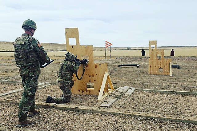 A Sniper engages targets from behind a barrier during the short-range tactical scenario of the Compact, Semi-Automatic Sniper Rifle (CSASS) operational test at Fort Carson, Colo.