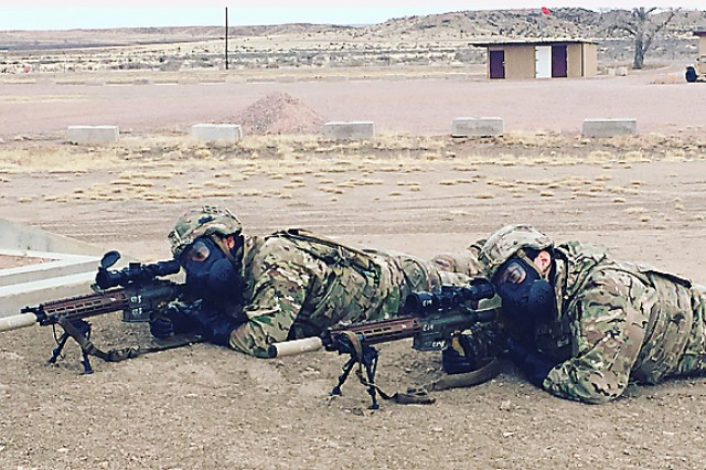 A Sniper Team fires the M110E1 Compact, Semi-Automatic Sniper Rifle (CSASS) in Mission Oriented Protective Posture (MOPP) gear during operational testing at Fort Carson, Colo.