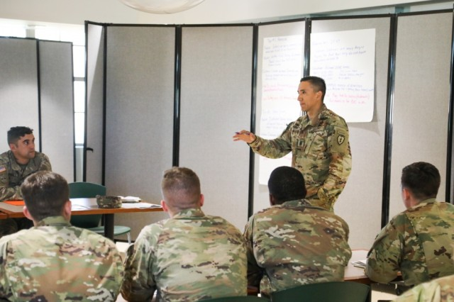 Command Sgt. Maj. Alex Kupratty, senior enlisted advisor for 3rd Squadron, 4th Cavalry Regiment, 3rd Brigade Combat Team, 25th Infantry Division, provides feedback during a workshop for the Not in My Squad initiative at Schofield Barracks, Hawaii, Nov. 8, 2018. The service has now spread the program to 27 ready and resilience campuses on Army installations. The initiative was started by Sgt. Maj. of the Army Daniel A. Dailey.