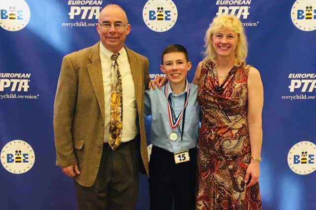 2019 European Parent Teacher Association Regional Spelling Bee Champion Robert Louis Rasmussen III poses with his proud parents, Robert and Joanie Rasmussen, Feb. 23 at Ramstein Elementary School after securing a trip to compete in the Scripps National Spelling Bee.