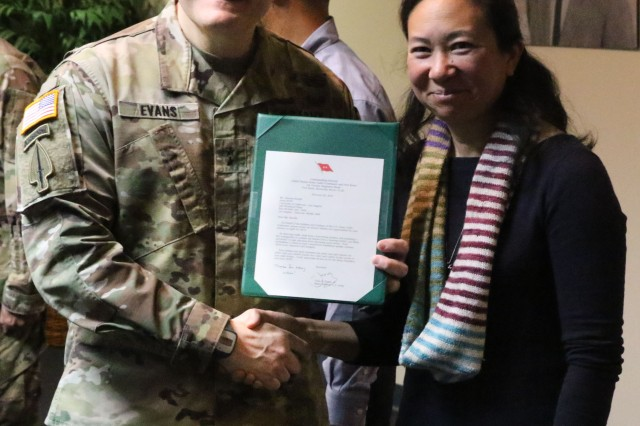 Maj. Gen. John Evans, commander of U.S. Army Cadet Command, presents Victoria Sanelli with a two-star congratulatory note and a commanding general's coin during a ceremony at UCLA Feb. 27 for actions she took last April while assisting during a traffic accident.