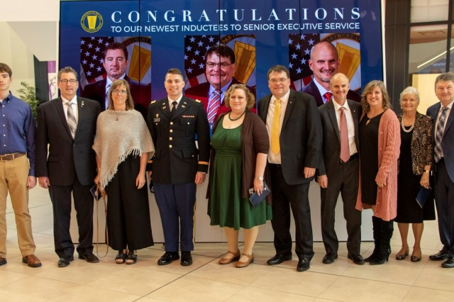 Senior Executive Service members Dr. Lance Hansen, Dr. David Horner and Dr. Ty Wamsley and their families attend a ceremony in their honor at the U.S. Army Engineer Research and Development Center in Vicksburg, Miss.