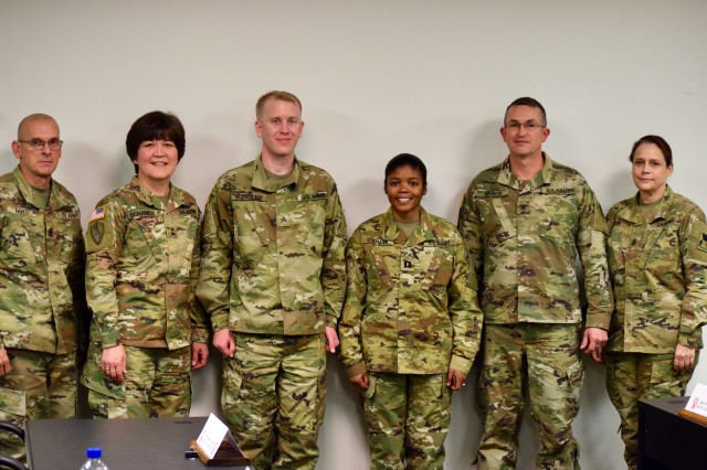 Maj. Gen. Miyako Schanely, 416th Theater Engineer Command commanding general, recognized Sgt. Clint Kessler and Capt. Latrice Coleman with challenge coins for their outstanding efforts planning and hosting the yearly training brief March 2, 2019, in Wichita, Kansas. Command teams and staff from the 420th Engineer Brigade, 647th Regional Support Group and subordinate units were gathered to conduct their yearly training briefs with the 416th TEC leadership.
