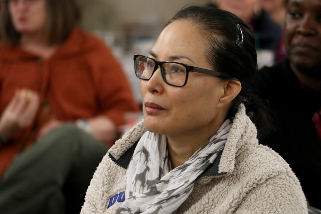 Lt. Col. (Dr.) Kyong Hyatt , a nurse scientist with Madigan Army Medical Center's Center for Nursing Science and Clinical Inquiry listens to a presentation at the 10th annual Lt. Col. Juanita Warman Nursing Excellence Conference hosted by Madigan Army Medical Center's Medical-Surgical Nursing Service Feb. 22 at the American Lake Conference Center on Joint Base Lewis-McChord, Wash.