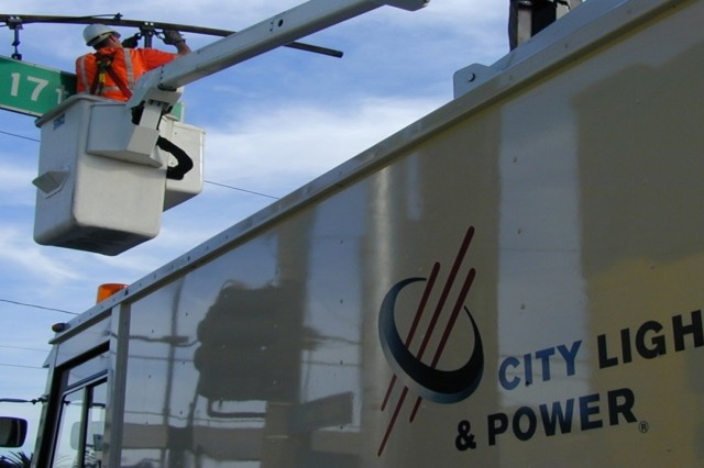 A City Light and Power lineman works on a pole mounted transformer recently.