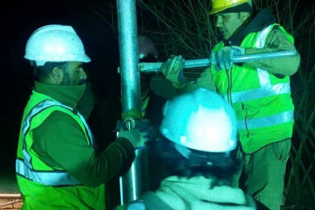 Assessment of the damage takes place around 9:30 p.m. with the team bringing up the pump.