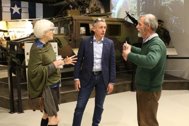 Dr. John O'Brian (right), director of the Don F. Pratt Memorial Museum, conducts a tour of the museum on Fort Campbell, Feb. 25, for Helen Ayer Patton (left), granddaughter of the legendary Gen. George S. Patton, Jr., and Hans Van Kessel (center) curator for the 101st Airborne Museum Le Mess in Bastogne, Belgium. During her visit, Patton met with the division's senior leadership and toured the division headquarters, the Don F. Pratt Memorial Museum, several memorials and The Sabalauski Air Assault School. (U.S. Army photo by Sgt. James Griffin, 1st Brigade Combat Team Public Affairs)