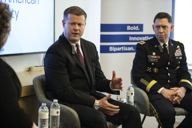 Under Secretary of the Army Ryan McCarthy (left) speaks to a group of reporters on the Army's plans to further modernize its forces at the Center for New American Security in Washington, D.C. Also taking part in the press briefing is Lt. Gen. Eric Wesley, head of Army Futures Command's Futures and Concepts Center.