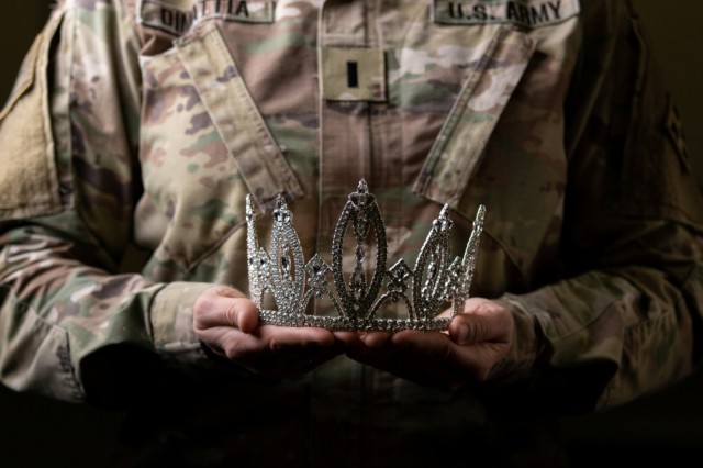 First Lieutenant Angela DiMattia, family readiness leader, 52nd Brigade Engineer Battalion, 2nd Infantry Brigade Combat Team, 4th Infantry Division, holds her 2019 Ms. Colorado crown, Feb. 12, 2019, while in her duty uniform at Fort Carson, Colo. DiMattia competed in the beauty pageant to bring awareness to local charities that support Soldiers and their Families.