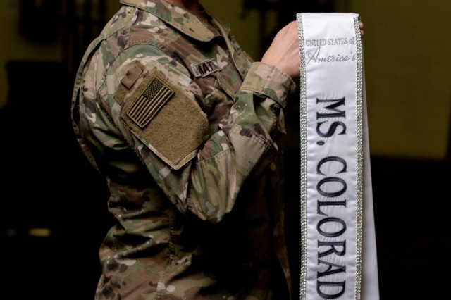 "First Lieutenant Angela DiMattia, assigned to 52nd Brigade Engineer Battalion, 2nd Infantry Brigade Combat Team, 4th Infantry Division, poses with a sash that reads, ""United of States of America's Ms. Colorado 2019"" during a photo shoot at the Headquarters and Headquarters Battalion performance center, Fort Carson, Colo., Feb. 12, 2019."