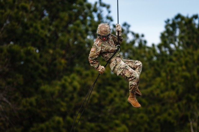Spc. Adam Manternach, a public affairs specialist with the 22nd Mobile Public Affairs Detachment, Headquarters and Headquarters Battalion, XVIII Airborne Corps, rappels from a UH-60 Black Hawk during a multi-day Air Assault training event at Fort Bragg, N.C., Feb. 13, 2019. The Soldiers who participated in the training learned the basics of Air Assault operations from the instructors of the DeGlopper Air Assault School. (U.S. Army photo by Pfc. Hubert D. Delany III / 22nd Mobile Public Affairs Detachment)