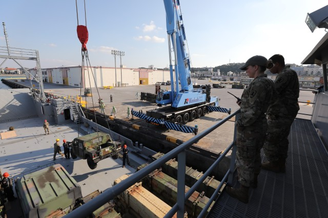 A Soldier with the 10th Support Group Regional supervises the loading of equipment onto the Landing Craft Utility (LCU) 2010 at Naha Military Port Okinawa, Japan, Jan. 25. (U.S. Army Photo by Sgt. 1st Class Nancy Lugo)