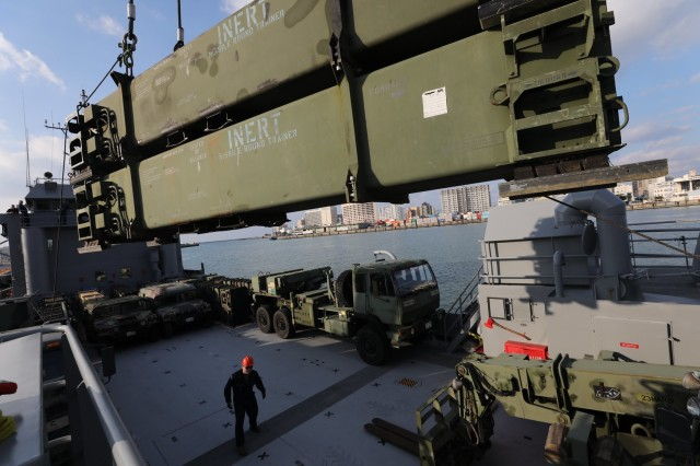 Patriot Missile Round Trainers are hoisted onto the Landing Craft Utility (LCU) 2010 at Naha Military Port Okinawa, Japan, Jan. 25. (U.S. Army Photo by Sgt. 1st Class Nancy Lugo)