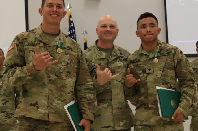 2019 Best Warrior Competition NCO winner Sgt. Christopher Hadley, Bravo Co., 100th Battalion, 442nd Infantry Regiment and Soldier of the Year Spc. John Aquino, Echo Co., 100th Battalion, 442nd Infantry Regiment flank Brigadier General Douglas Anderson, Commander of 9th Mission Support Command, at Fort Shafter Flats on March 3, 2019.