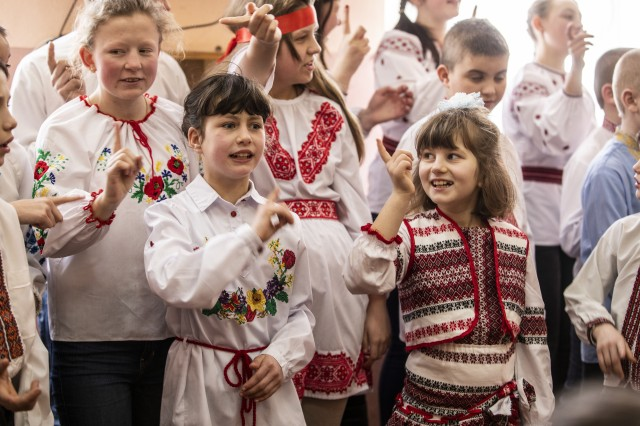 Students from the Rehabilitation Center for Children with Special Needs sing to multinational Soldiers during a visit to the orphanage in Krakovets, Ukraine, March 4.