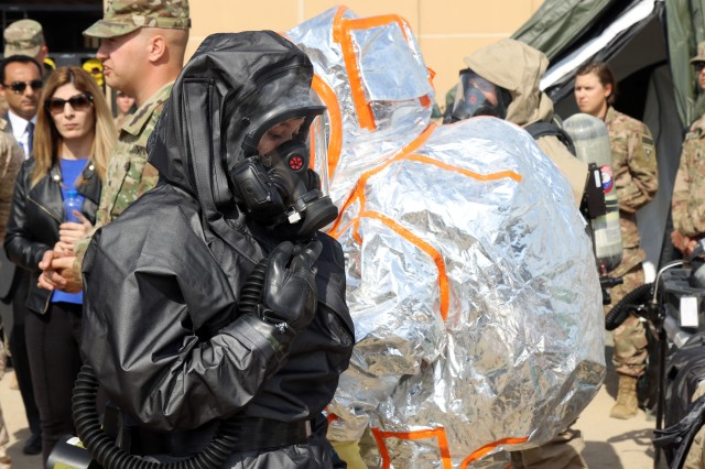 Soldiers from the 637th chemical, biological, radiological and nuclear Company display the proper wear and use of protective suits for different levels of contamination on Feb. 14, 2019, at Camp Arifjan, Kuwait. The Soldiers provide a display on the CBRN dismounted reconnaissance equipment to Kuwait Weapons of Mass Destruction Defense Command. The unit is deployed to Kuwait as the CBRN defense response force for the U.S. Central Command area of responsibility.