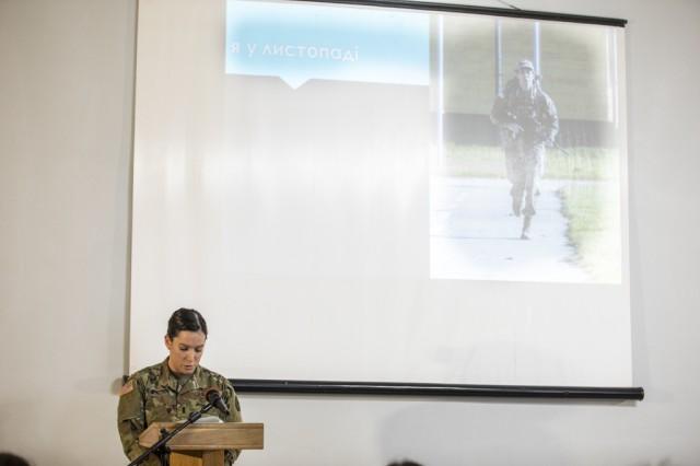 278th Armored Cavalry Regiment Officer, 1st Lt. Caitlin Maguire, speaks at the International Forum Regarding Gender Politics in the Defense Sector in Lviv, Ukraine, March, 5.