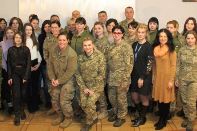 The speakers and audience members pose for a group photo at the International Forum Regarding Gender Politics in the Defense Sector in Lviv, Ukraine, March, 5.