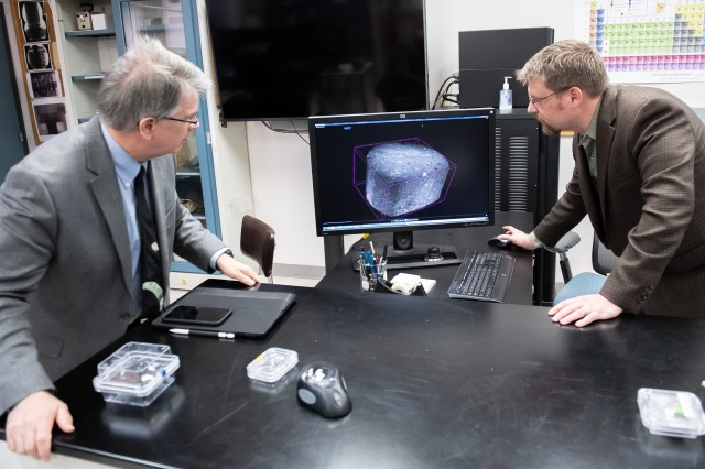 Dr. Justin S. Jones (right), a material engineer at NASA Goddard, and Dr. Jim Garvin, NASA Goddard's chief scientist, review an X-ray scan of a Martian meteorite. NASA collaborated with the Army to find answers to scientific mysteries.