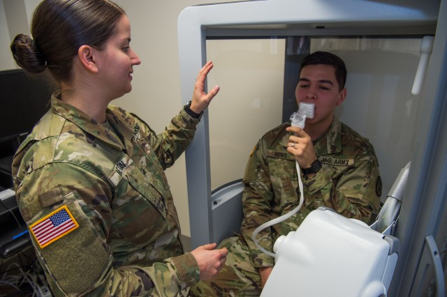 U.S. Army Sgt. Valeria Melton, McDonald Army Health Center NCO in charge of internal medicine, trains Spc. Health Howe, McDonald Army Health Center radiology specialist, on how a Pulmonary Function Test machine works at Joint Base Langley-Eustis, Virginia, Feb. 5, 2019. The PFT machine is used to show the respiratory therapist how well the patient's lungs are working. (U.S. Air Force photo by Senior Airman Tristan Biese)