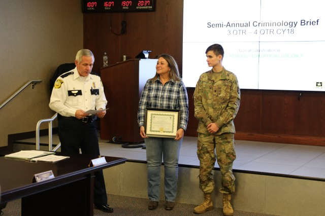 Oak Grove City Chief of Police Dennis Cunningham (left), and Oak Grove City Mayor Theresa Jarvis (center), present Spc. Sebatian Gorder with framed letters of appreciation, March 6, at Fort Campbell. Gorder, a combat medic assigned to Headquarters and Headquarters Battery, 2nd Battalion, 32nd Field Artillery Regiment, 1st Brigade Combat Team, 101st Airborne Division (Air Assault), and his wife, Kaily, also a combat medic who is currently deployed to Kuwait with Troop B, 1st Battalion, 32nd Cavalry Regiment, 1st BCT, were publically recognized for their live saving efforts and quick response to their neighbor's violent home invasion in Oak Grove, Ky., Dec. 5, 2018. (U.S. Army photo by Sgt. James M. Griffin)