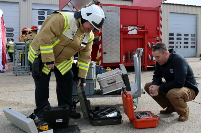 Michael Hill, United States Army Garrison - Rhineland Pfalz assistant fire chief and deputy heath and safety officer, shows some of the departments decontamination equipment with Army Capt. Josh Varnadoe, 773rd Civil Support Team, 361st Civil Affairs Brigade, 7th Mission Support Command survey team leader, during a decontamination training event, March 6, at Fire Station 2 on Sembach Kaserne in Sembach, Germany. The event served as an opportunity for both organizations to build relationships and increase interoperability for a stronger Europe.