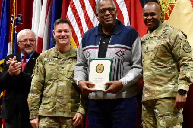 USAG Ansbach Commander Col. Steven M. Pierce recognized Charles B. Forbes for 50 years of service to the U.S. military March 1, 2019. Command Sgt. Major Philson Tavernier and Mayor Förster from Illesheim assisted.