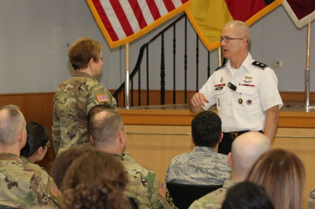 Maj. Gen. Ron Place, Director, National Capital Region and transition Intermediate Management Organization for the Defense Health Agency, responds to a question during a town hall meeting at Landstuhl Regional Medical Center Feb. 28.