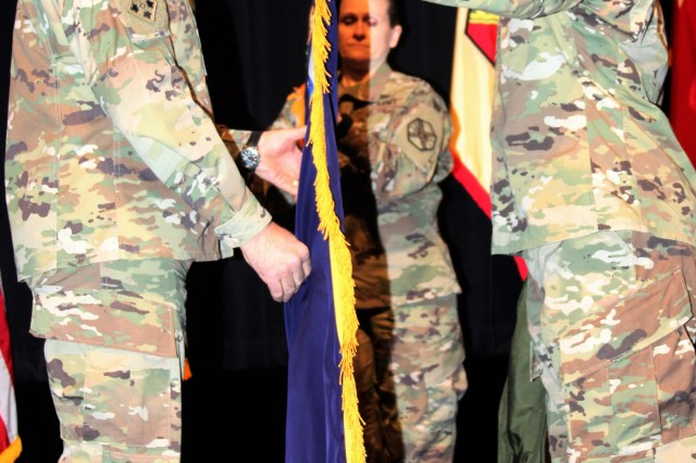 Gen. Gus Perna (left), commanding general of Army Materiel Command, assists in unfurling the AMC flag, along with IMCOM Command Sgt. Maj. Melissa A. Judkins and Lt. Gen. Bradley A. Becker, IMCOM commanding general. An assumption of authority ceremony was held March 8 at Joint Base Fort Sam Houston, Texas, to commemorate IMCOM becoming a major subordinate command of AMC.