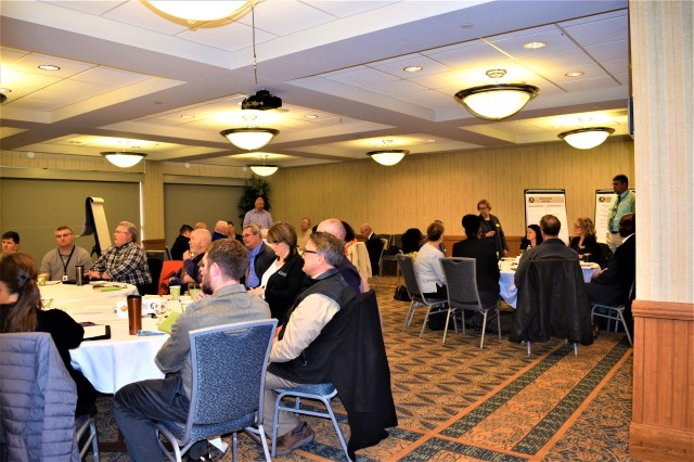 Heather Stewart, analyst with Plans, Analysis and Integration Office, U.S. Army Garrison Fort Riley, speaks to regional partners during the Flint Hills Partnership meeting Feb. 27.