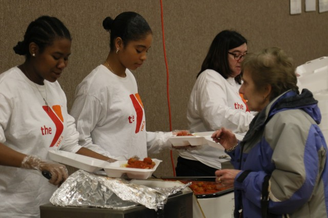 Soldiers with the 10th Sustainment Brigade volunteer to help by serving food to the local community during a Dollar Dinner event held by the YMCA and the Watertown Urban Mission Mar. 6, 2019 in Watertown, NY.