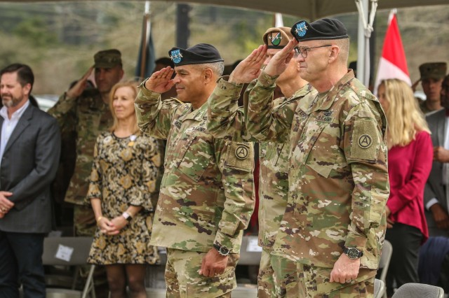 From left to right, Lt. Gen. Michael X. Garrett, former commanding general of U.S. Army Central, Gen. Joseph L. Votel, commanding general of U.S. Central Command, and Lt. General Terry Ferrell, current commanding general of USARCENT, salute the colors during USARCENT's change of command ceremony at Lucky Park, outside of the command's headquarters, Shaw Air Force Base S.C., Mar. 8, 2019. Garrett relinquished command and control of USARCENT to Ferrell. (U.S. Army photo by. Staff Sgt. Matt Britton / U.S. Army Central)