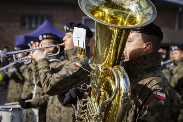 Members of the Polish Army band play to celebrate Poland's 20th year anniversary as a member of NATO, here, Mar. 8, 2019. The event was open to the public as approximately 1,000 locals were in attendance to visit and learn about the Polish and American militaries.