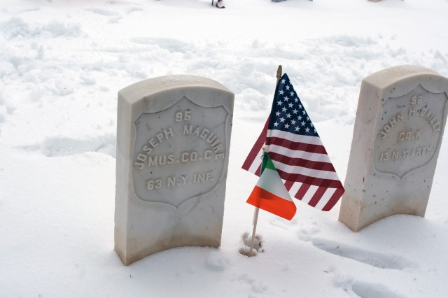 An American and Irish flag marks the grave of Pvt. Joseph Maguire, a Musician in the Irish Brigade's Company C, 63rd New York Volunteer Infantry Regiment following a flag placing ceremony at the Soldiers Lot in Albany Rural Cemetery on March 10, 2019. Maguire served in the Civil War and died in March 1867. Veterans of the New York National Guard's 1st Battalion 69th Infantry who live in the Albany, N.Y.- area marked the graves of Irish-American Civil War Soldiers at Albany Rural Cemetery and St. Agnes Catholic Cemetery to acknowledge the link between their service and the 69th Infantry, which was historically an Irish-American unit and part of the Irish Brigade during the war.