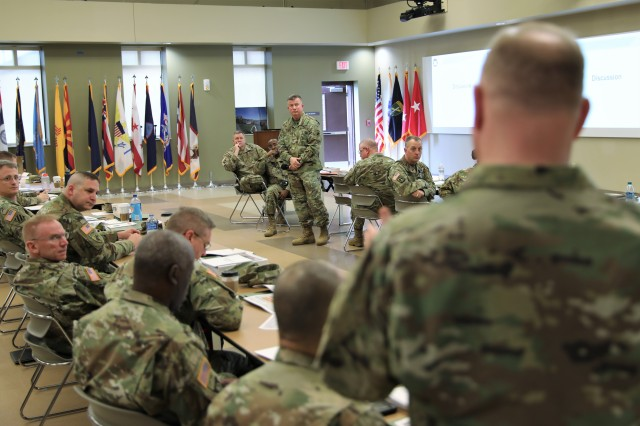 Maj. Gen. Darrell Guthrie, United States Army Civil Affairs & Psychological Operations Command (Airborne) commanding general, listens to a question during the Yearly Training Brief Monday, March 4, 2019 at the USACAPOC(A) headquarters building on Fort Bragg. N.C.