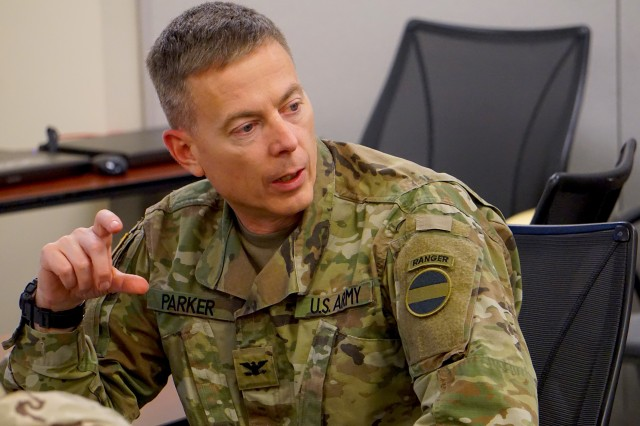 Col. Timothy Parker, the FORSCOM G2 Intelligence Officer, receiving a brief from the 1BCT Intelligence Team during the Tier II MITS evaluation at the Foundry Site on Fort Bragg, North Carolina.