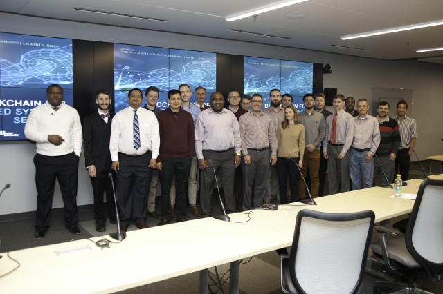 Attendees of the ARL-hosted Symposium on Blockchain for Distributed System Security pose for a group photo in ARL's Network Science Research Laboratory in Adelphi, Maryland.