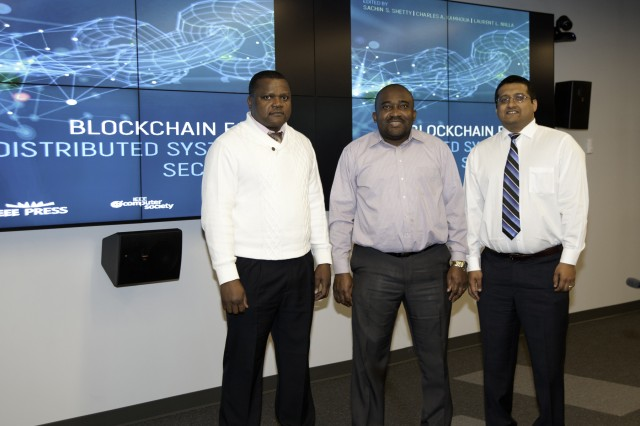 From left to right, Dr. Laurent Njilla (AFRL), Dr. Charles Kamhoua (ARL), and Dr. Sachin Shetty (ODU) pose for a photo during the Symposium on Blockchain for Distributed System Security.
