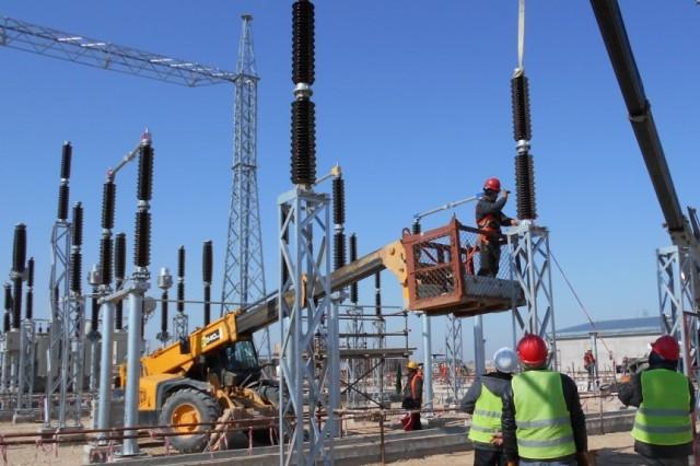 Installation of post insulators at Shaheen substation in progress.