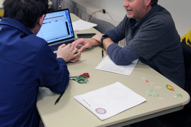 BALTIMORE -- Sam Septembre, a federal systems integrator with FireEye, a cybersecurity company, taught cypher coding to young people at the 'Teens + STEM = Opportunities' event at the Brooklyn Park Community Library, March 9.
