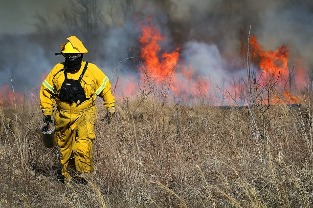 Limnologist Tony Clyde with the U.S. Army Corps of Engineers, Tulsa District walks to refuel his torch during a prescribed burn training class March 4-8, 2019, at Ft. Gibson Lake near Okay, Okla. The training class is an annual event in its 11th year and teaches natural resource specialists and lake maintenance staff how to properly and safely conduct a burn.