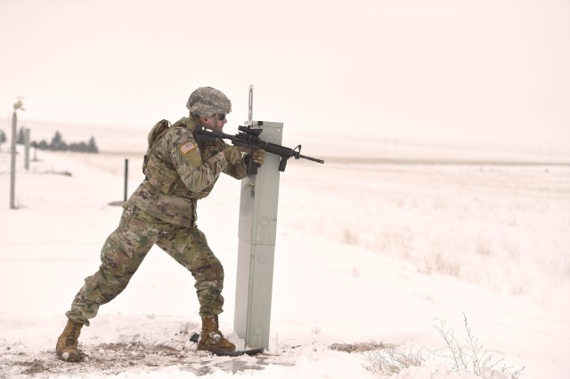 Sgt. Sol Griffith, a fire team leader, assigned to the Wyoming Army National Guard's C Company, 1st Battalion, 297th Infantry Regiment (Forward), demonstrates the proposed new rifle marksmanship evaluation, from the standing supported position. The deploying infantry unit was the first to try out the new test at Camp Guernsey, during mobilization training March 7, 2019.