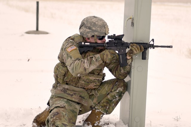 Sgt. Sol Griffith, a fire team leader, assigned to the Wyoming Army National Guard's C Company, 1st Battalion, 297th Infantry Regiment (Forward), demonstrates the proposed new rifle marksmanship evaluation, from the kneeling supported position. The deploying infantry unit was the first to try out the new test at Camp Guernsey, during mobilization training March 7, 2019.