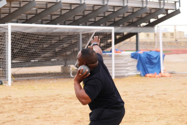 U.S. Army Sgt. Ricardo Berry, 1st Air Combat Brigade, 1st Cavalry Division, Fort Hood Texas, takes a practice throw with the shot put before the field event officially begins at the Army Trials. The 2019 Army Trials, hosted at Fort Bliss, is an adaptive sports competition from March 5-16 with over 100 wounded, ill and injured active-duty Soldiers and veterans competing in 14 different sports for the opportunity to represent Team Army at the 2019 Department of Defense Warrior Games in Tampa, Fla.