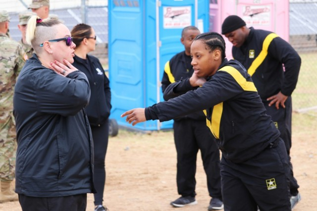 U.S. Army veteran Erin Holmes, left, offers throwing tips to U.S. Army Spc. Nakita Bowen between shot put throws, March 11, at the Army Trials. The 2019 Army Trials, hosted at Fort Bliss, is an adaptive sports competition from March 5-16 with over 100 wounded, ill and injured active-duty Soldiers and veterans competing in 14 different sports for the opportunity to represent Team Army at the 2019 Department of Defense Warrior Games in Tampa, Fla.