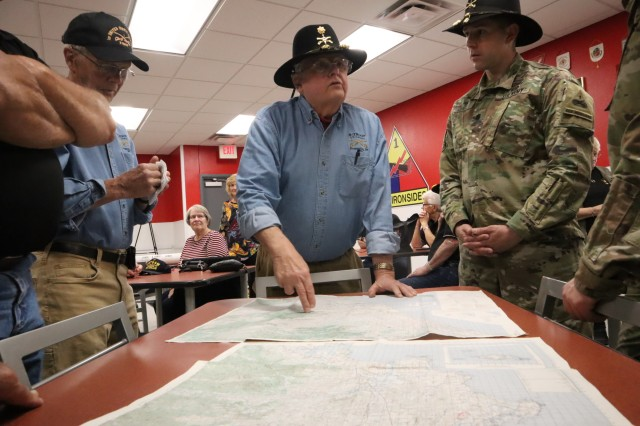Retired Army Maj. Walter Reed, who was once commander of Bravo Troop during the Vietnam War, retraces his missions on an old topographic map that was used during the war. Iron Soldiers assigned to the 1st Squadron, 1st Cavalry Regiment, 2nd Armored Brigade Combat Team got the chance to meet a very special group of Vietnam veterans who were assigned to the 1-1 CAV during a visit to Fort Bliss, Texas March 8.