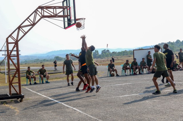 A Philippine army soldier makes a basket during a game of basketball played against U.S. Army Soldiers during a sports day held as part of Exercise Salaknib 19 at Fort Magsaysay, Philippines, March 11, 2019. Salaknib is an annual exercise designed to contribute to and enhance U.S. and Philippine defense readiness and tactical interoperability while strengthening multinational relationships. (U.S. Army photo by Elizabeth Johnson, 128th MPAD)