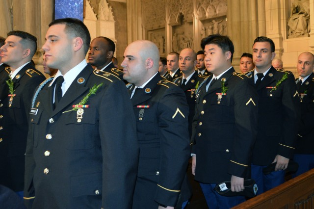 Soldiers of the New York Army National Guard's 1st Battalion 69th Infantry attend mass at St. Patrick's Cathedral in New York City prior to marching in the St. Patrick's Day Parade on March 18, 2018. Soldiers of the 1st Battalion 69th Infantry marched in the New York City St. Patrick's Day Parade on Saturday, March 17, 2018. The battalion's Soldiers have led the St. Patrick's Day parade since 1851.