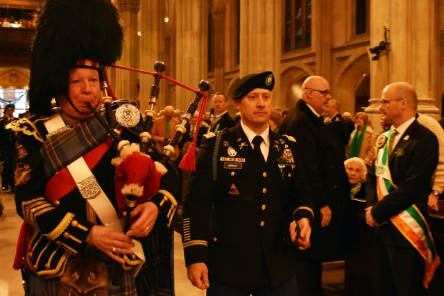 N.Y. Army National Guard Lt. Col. Don Makay, the commander of the 1st Battalion, 69th Infantry Regiment, enters St. Patrick's Cathedral in New York City, on March 17, 2018, with the regimental piper by his side. The 69th was participating in the traditional St. Patrick's day Mass before marching in the 257th St. Patrick's day parade.