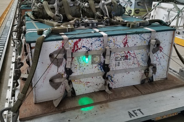 A reusable LED is placed on the back of an air drop pallet at McChord Field in 2016. The reusable LED is being tested as an alternative to single-use chemlights and expected to be durable, effective, and provide significant life cycle cost savings.